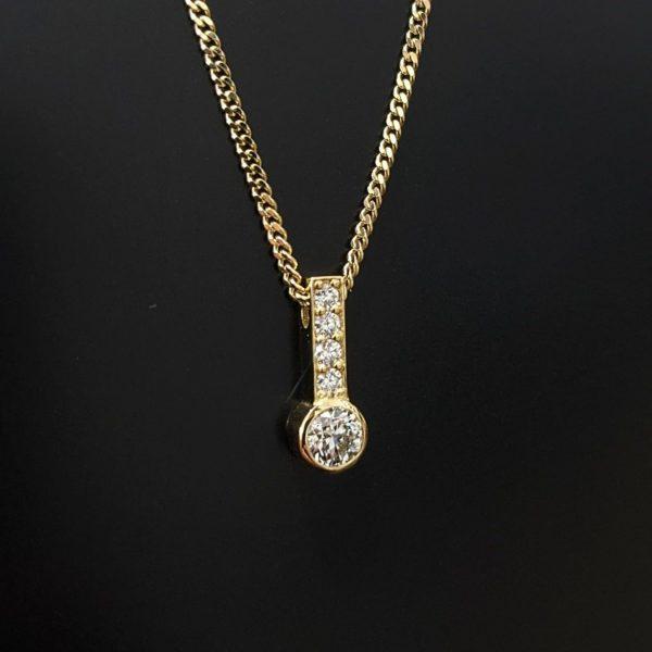 diamond drop pendant in yellow gold for women