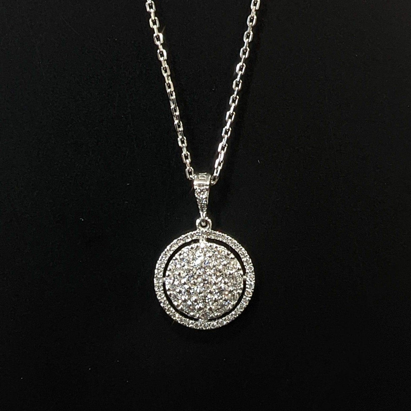 diamond ladies necklace with a diamond halo handmade in 18ct white gold