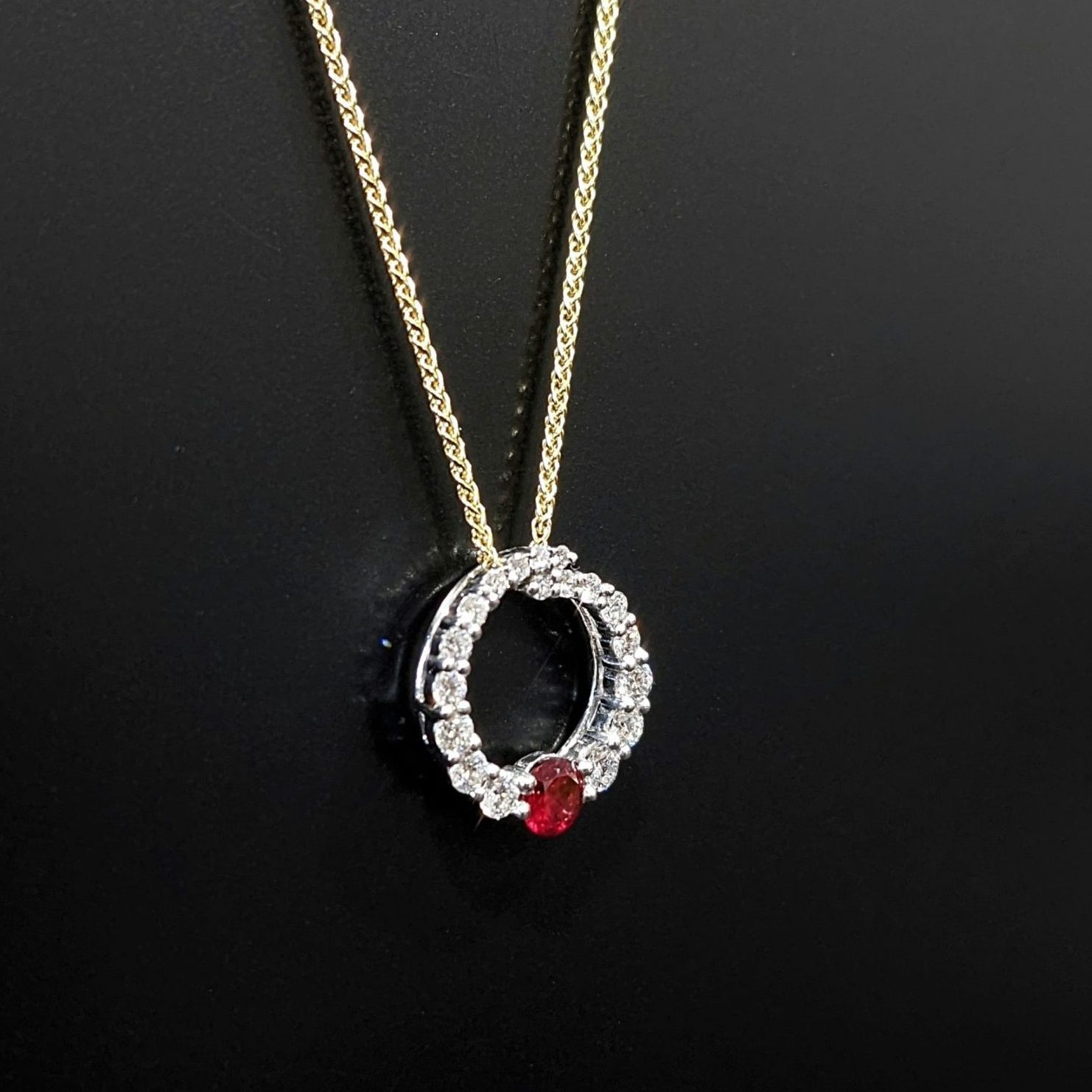 ruby and diamond pendant with yellow gold chain